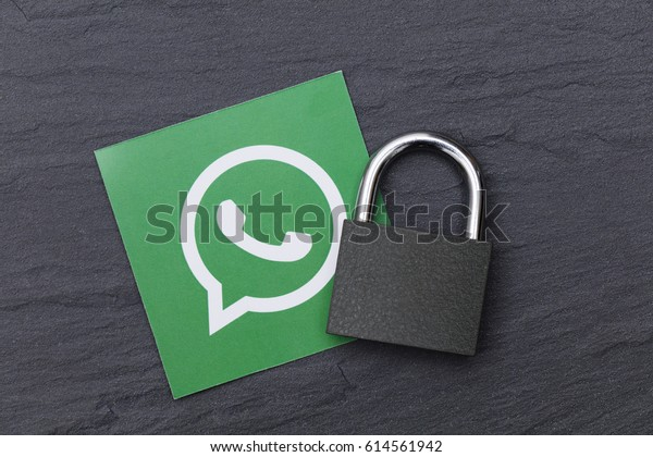 LONDON, UK - MARCH 29 2017: Photograph of the WhatsApp logo with a padlock. WhatsApp is an online instant messaging service