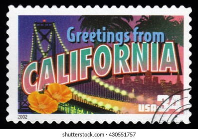 London, UK, March 30 2011 - Vintage 2002 United States of America cancelled postage stamp  showing an image of  Greetings From California with the Golden Gate Bridge and California Poppy