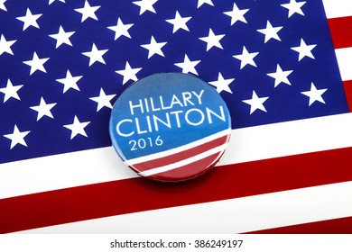 LONDON, UK - MARCH 3RD 2016: A Hillary Clinton 2016 pin badge over the US flag symbolizing her campaign to become the next President of the United States, 3rd March 2016.