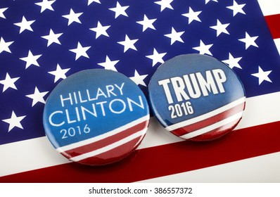 LONDON, UK - MARCH 3RD 2016: Hillary Clinton and Donald Trump pin badges over the American flag, symbolizing their battle to become the next President of the United States, 3rd March 2016.