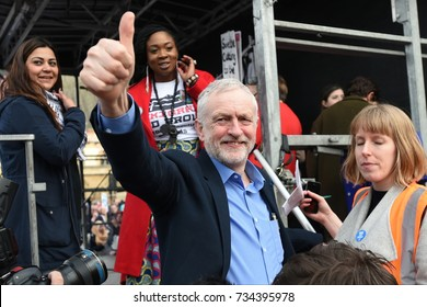 London, UK - March 4, 2017: Labour leader Jeremy Corbyn gestures to supporters during a demo in support of the NHS. Thousands marched against NHS spending cuts, hospital closures and privatisation.