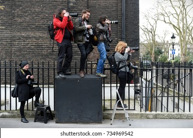 London, UK - March 4, 2017: Photojournalists line up on an exchange box as protesters rally in support of the NHS. Thousands protesting against NHS spending cuts, hospital closures and privitisaion.