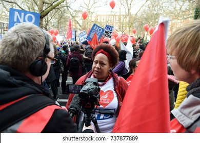 London, UK - March 4, 2017: News media interview a protester during a rally in support of the NHS. Thousands protested against NHS spending cuts, hospital closures and privatisation.