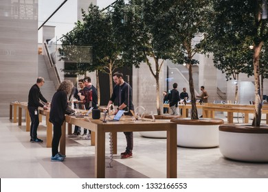 London, UK - March 6, 2019: Through the window view of the interior of Apple Store on Regent Street, London, UK. Regent Street was Apple's first store in Europe.
