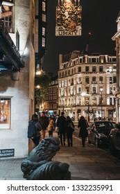 London, UK - March 6, 2019: People walking in front of Liberty Department Store in London, in the evening. Opened in 1875, it is famous for luxury goods and classic Liberty designs.