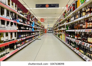 London, UK - March 7, 2015: View of an aisle at the alcoholic beverages section of a Sainsbury's supermarket. Sainsbury's is the UK's 2nd largest supermarket with a revenue of £23 billion in 2013.