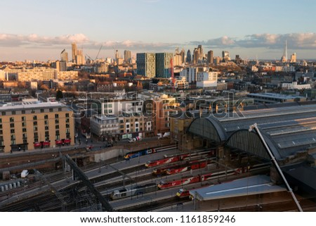 LONDON, UK - MARCH 7, 2018 : High, wide, daytime view of  London's skyline, with King's Cross Station in the foreground and the city landmarks in the disance