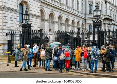 London, UK - March 7th, 2018: Tourist group in front of the entrance to 10 Downing Street