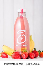 LONDON, UK - MAY 03, 2018: Bottle of Innocent strawberry and banana smoothie fruit drink with vitamins and fresh fruits.