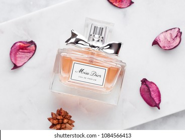 LONDON, UK - MAY 03, 2018: Glass bottle of Miss Dior luxury perfume on marble background.Dior is a fashion house founded in Paris.