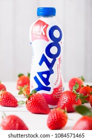 LONDON, UK - MAY 03, 2018: Plastic bottle of Yazoo strawberry drink on wooden background.