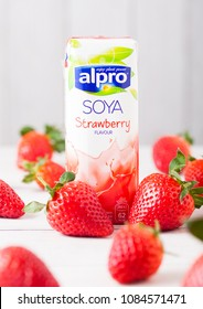LONDON, UK - MAY 03, 2018: Pack of Alpro Soya strawberry milk drink on wooden background.
