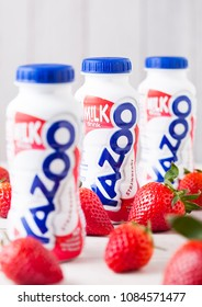 LONDON, UK - MAY 03, 2018: Plastic bottles of Yazoo strawberry drink on wooden background.