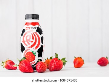 LONDON, UK - MAY 03, 2018: Plastic bottle of Muller strawberry drink on white.