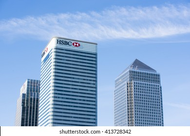LONDON, UK - MAY 1, 2016: Cropped shot of Canary Wharf HSBC bank building next to skyscrapers against blue sky. Canary Wharf is London's second financial district.