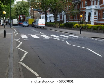 LONDON, UK - MAY 10: Abbey Road zebra crossing and recording studios made famous by the 1969 Beatles album May 10, 2010 in London, UK