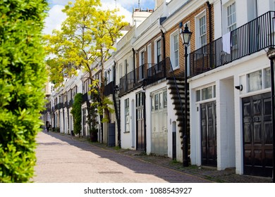 LONDON, UK - MAY 10th, 2018: Holland Park Mews is a cobbled through road approached through its own arch off Holland Park in the Royal Borough of Kensington and Chelsea.
