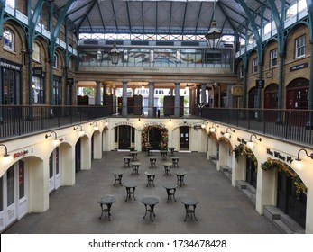 London / UK - May 10th 2020: London's normally busy Covent Garden market and piazza popular tourist destinations are nearly empty as people are told to stay at home during the COVID-19 coronavirus