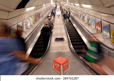 LONDON, UK - MAY 12 2015:Passengers on London Underground escalator. The Deepest station below street level is Hampstead (Northern line) - 58.5 metres.