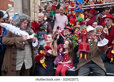LONDON, UK- MAY 12: An International gathering of Punch and Judy Professors, with an actor as Samuel Pepys who fist saw Mr Punch in 1662, celebrating Punch's 350th birthday. May 12, 2012 in London UK. unidentified children