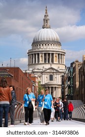 LONDON, UK - MAY 13, 2012: People walk the Millennium Bridge in London. With more than 14 million international arrivals in 2009, London is the most visited city in the world (Euromonitor).