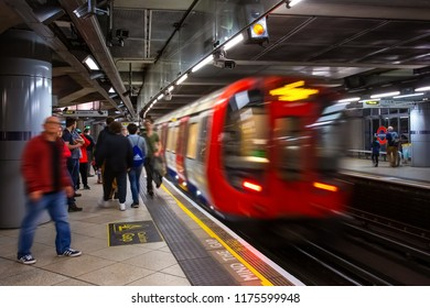 London, UK - May 13 2018: Unidentified people travel through underground train network in London