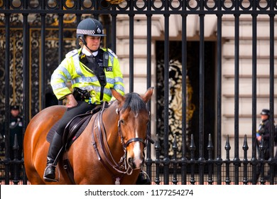LONDON, UK - MAY 13 2018: Unidentified police officer is on duty during the changing of the guard at Buckingham Palace