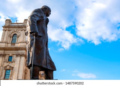London, UK - May 13 2018: Statue of Winston Churchill at the Parliament Square with other twelve statues of statesmen and other notable individuals