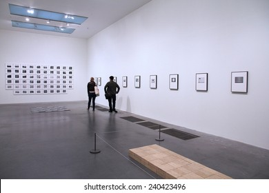 LONDON, UK - MAY 14, 2012: People visit Tate Modern gallery in London. It is the most-visited modern art gallery worldwide, with around 4.7 million visitors per year.