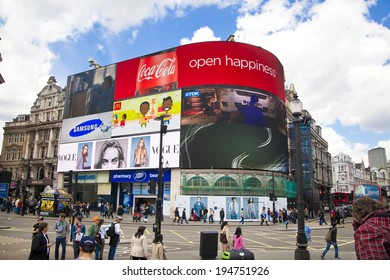 LONDON, UK - MAY 14, 2014: People and traffic in Piccadilly Circus in London. Famous place for romantic dates.Square was built in 1819 to join of Regent Street