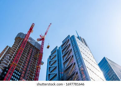 London, UK - May 14, 2019: Low angle view of office buildings under construction in the City of London against blue sky.