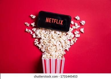 LONDON, UK - MAY 14 2020: Netflix logo on a smartphone with popcorn