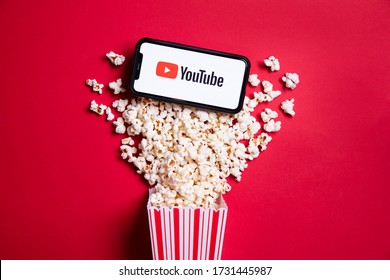 LONDON, UK - MAY 14 2020: Youtube logo on a smartphone with popcorn