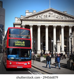 LONDON, UK - MAY 15, 2012: People ride London Bus in London. As of 2012, LB serves 19,000 bus stops with a fleet of 8000 buses. On a weekday 6 million rides are served.