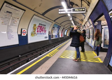 LONDON, UK - MAY 15, 2012: Travelers wait at Camden Town underground station in London. London Underground is the 11th busiest metro system worldwide with 1.1 billion annual rides.