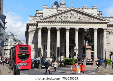 LONDON, UK - MAY 15, 2012: People visit Bank Junction in London. Royal Exchange building in background was originally built for trading stocks. Now it's used as luxury shopping mall.