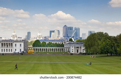 LONDON UK - MAY 15, 2014: Old English park south of London and view on Canary Wharf business district