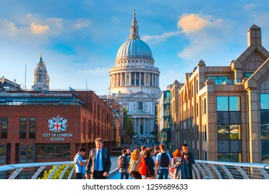 London, UK - May 15 2018: View of St Paul's Cathedral with people crossing the Millenium Bridge (London Millennium Footbridge)