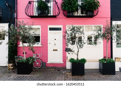 London, UK - May 15, 2019: Pink color painted house in St Lukes Mews alley near Portobello Road in Notting Hill