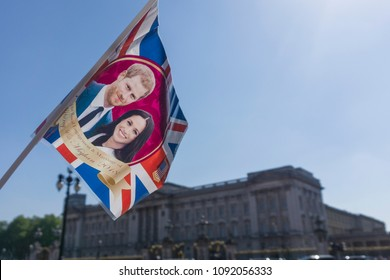 LONDON, UK - MAY 15th 2018: Union jack flag with Prince Harry and Meghan Markle on is waved outside buckingham palace before the Royal Wedding takes place in Windsor