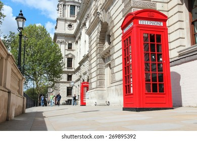 LONDON, UK - MAY 16, 2012: People walk by red telephone booth in London. With more than 14 million international arrivals in 2009, London is the most visited city in the world (Euromonitor).