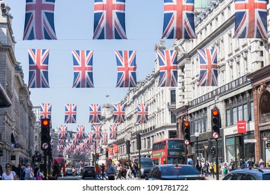 LONDON, UK - MAY 16th 2018: Union Jack flags hang in Regent Street, Central London in preperation for the royal wedding of Prince Harry and Meghan Markle