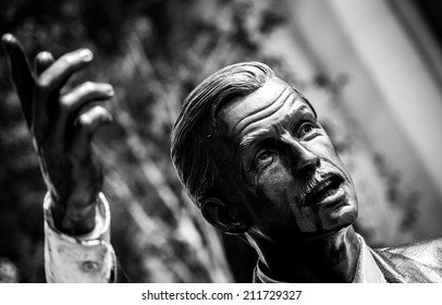 LONDON, UK - MAY 17, 2014: Photo of Taxi, a statue by American sculptor J. Seward Johnson Jr., situated in John Carpenter Street in London. Processed in B&W.