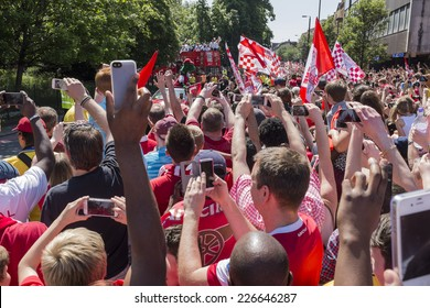 LONDON, UK - MAY 18, 2014 : Winners of the 2014 FA Cup, Arsenal Football Club parade their trophy around the streets of Islington north London on a red open top bus after defeating Hull City.