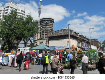 LONDON/ UK- MAY 18th 2018: People shopping at the market, in Barking town centre, east London.