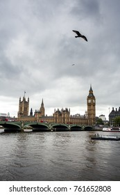 LONDON, UK - MAY 2, 2014: Big Ben and Houses of Parliament with boat in London, England, UK. Big Ben is London most famous symbol.