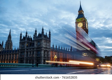 LONDON, UK - MAY 2, 2014: Double-decker bus passes pedestrians walking in front of Big Ben and Houses of Parliament on Westminster Bridge.