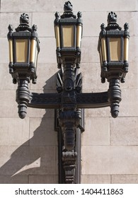 London / UK - MAY 20 2019: Black cast iron lanterns on the wall of the Freemason Hall, the headquarters of the United Grand Lodge and Supreme Grand Chapter of Royal Arch Masons of England.