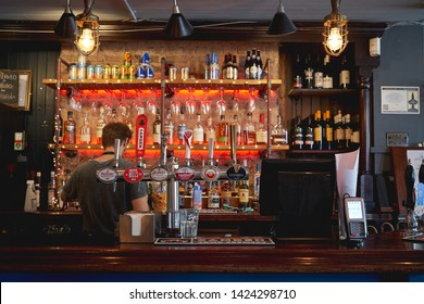 London, UK - May, 2019. Draught beer taps in a traditional pub in central London.
