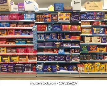 London, UK - May 2019: Supermarket aisle of Biscuits, Snacks, Cookies